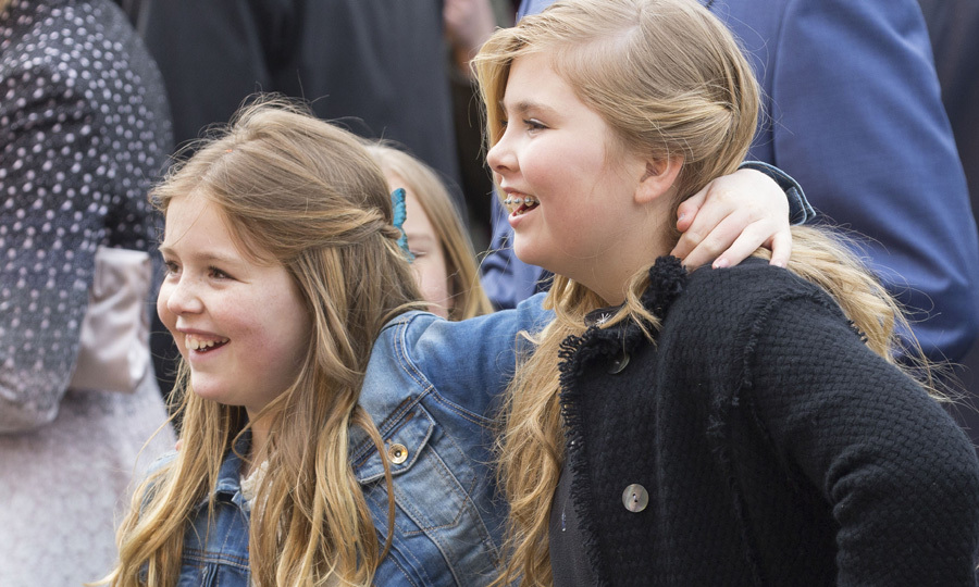 Smiling sisters Princess Alexia and Crown Princess Catharina-Amalia of the Netherlands had a great time attending birthday celebrations for their father on King's Day.