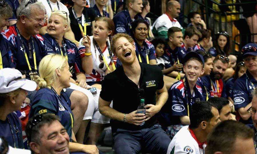 Harry couldn't resist a giggle as he sat among the crowd while watching the sitting volleyball match in Orlando.