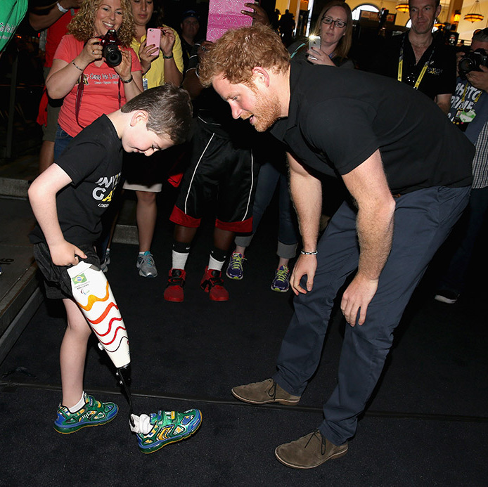 Rio showed off his cool sneakers to Prince Harry during the event. 