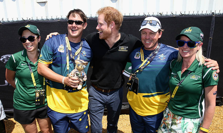 Prince Harry had some fun with medalist and Aussie supporters during the Jaguar Land-Rover Driving Challenge.