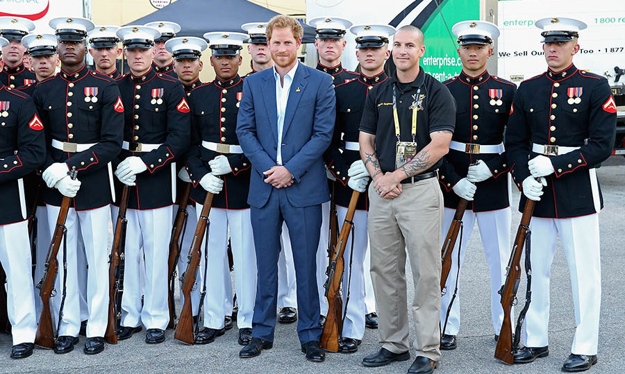 Prince Harry took some time to pose with the US Marine Corps Silent Drill Platoon before the start of the opening ceremony. 