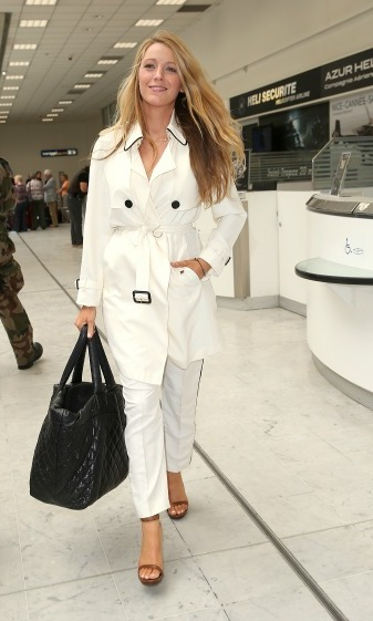 May 9: Mommy-to-be Blake Lively looked chic in all white as she made her way to the festival two days before the premiere of her latest film <i>Cafe Society</i>. 