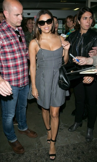 May 10: Eva Longoria offered a smile and stripes as she strutted through the airport. The actress will be fulling her duties as Lorealista for L'Oréal Paris. 