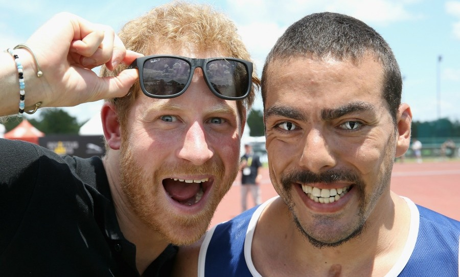 Harry snapped a fun picture with US athlete Michael Kacer during the track and field events. 