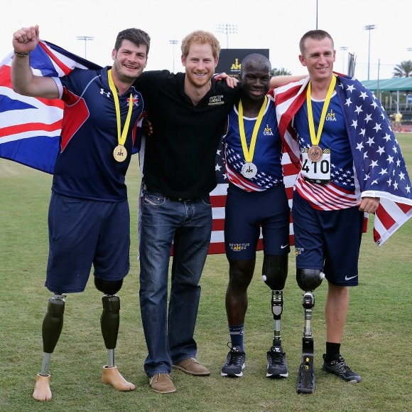 Harry posed with medal winners during the track and field events. 