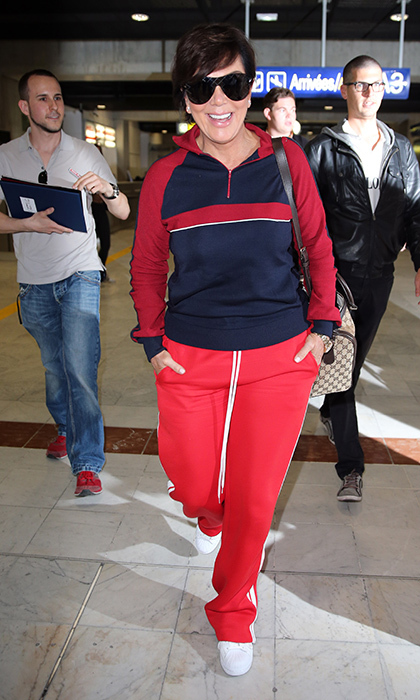 May 11: Comfort first! Kris Jenner arrived to the French Riviera wearing a red track suit, while flashing her bright smile for photographers. 