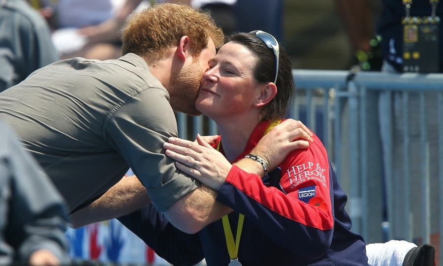 A kiss from Harry! Princess Charlotte's uncle passed out medals and even gave a few lucky athletes a kiss.