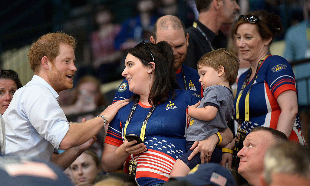 *Swoons* we think we'd have the same reaction if Harry placed his hand on our shoulder as he did with a lucky spectator at the Jaguar Landrover Challenge wheelchair rugby match.