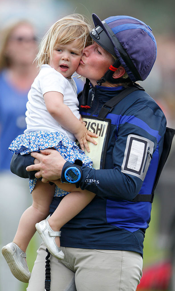 Mommy's little cheerleader! Zara planted a kiss on her daughter after competing in the cross country phase of the Badminton Horse Trials in 2016.