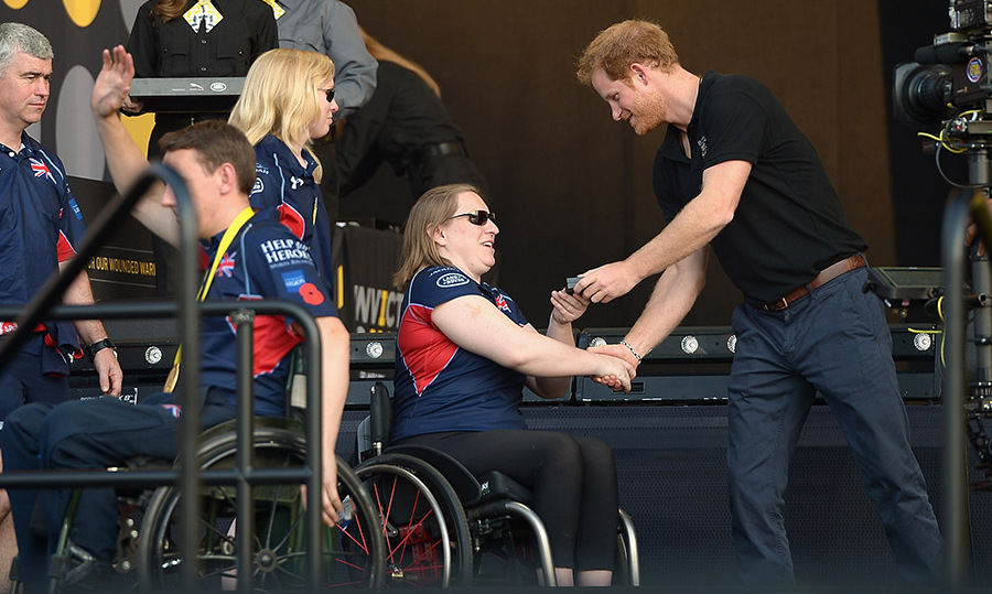Harry couldn't help but smile as he was greeted by one of the athletes during day five of the Invictus Games. 