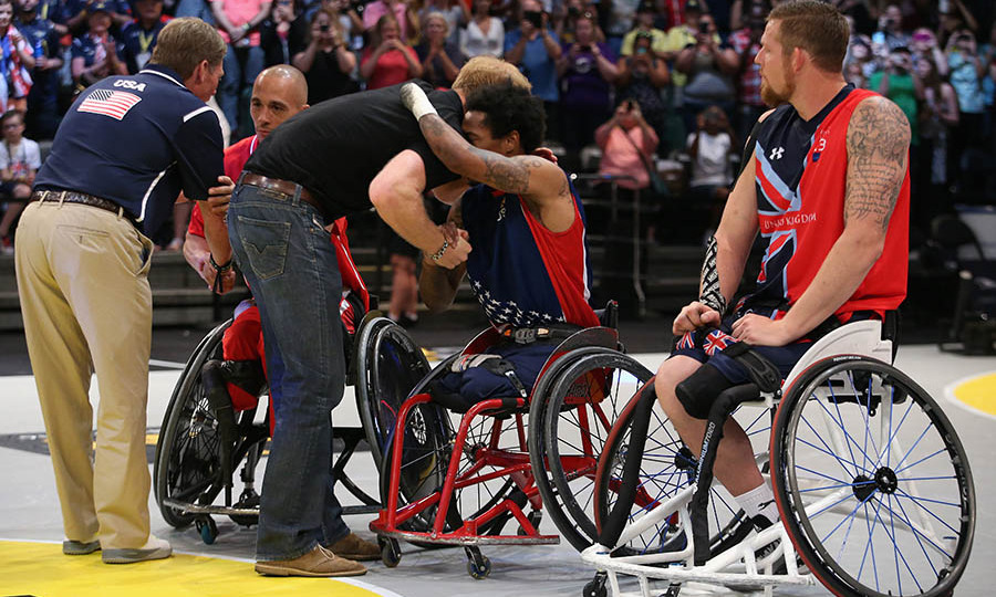 An inspired Prince Harry hugged the wheelchair basketball players on the final day of the competition. 