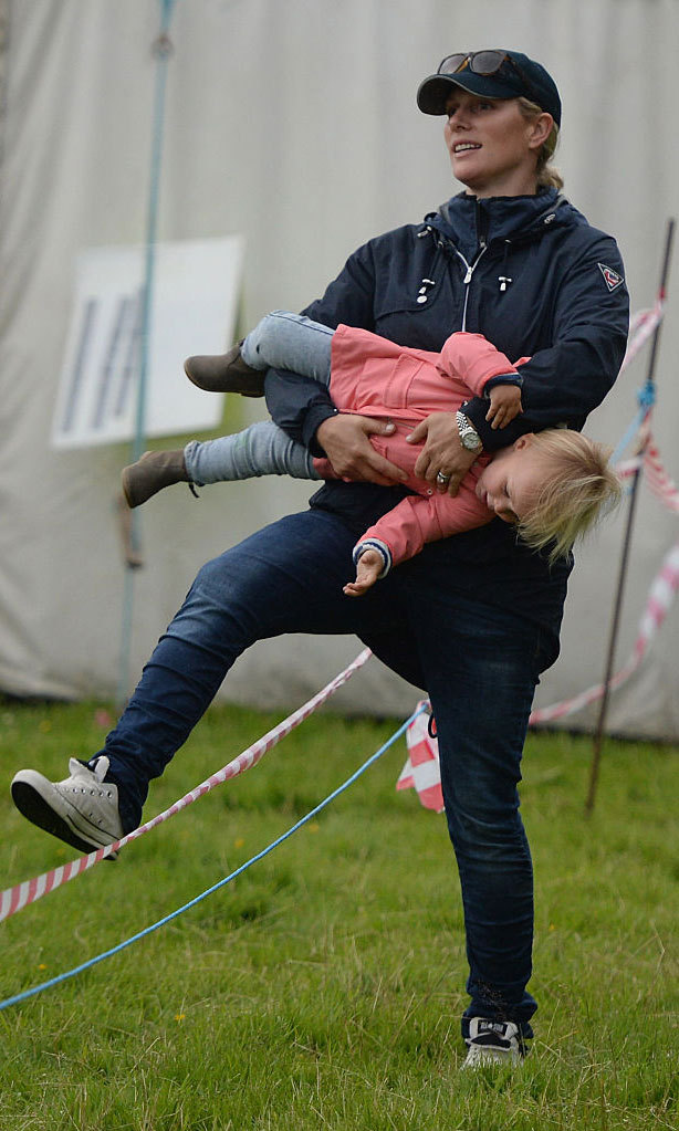 Girls just want to have fun! Zara playfully carried her daughter around while watching husband Mike compete in a quadrathlon.