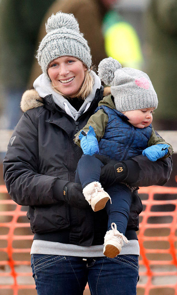 The Olympic medalist and her bundle of joy kept warm snuggled next to each other as they attended a horse race meet at Cocklebarrow Racecourse in 2015.