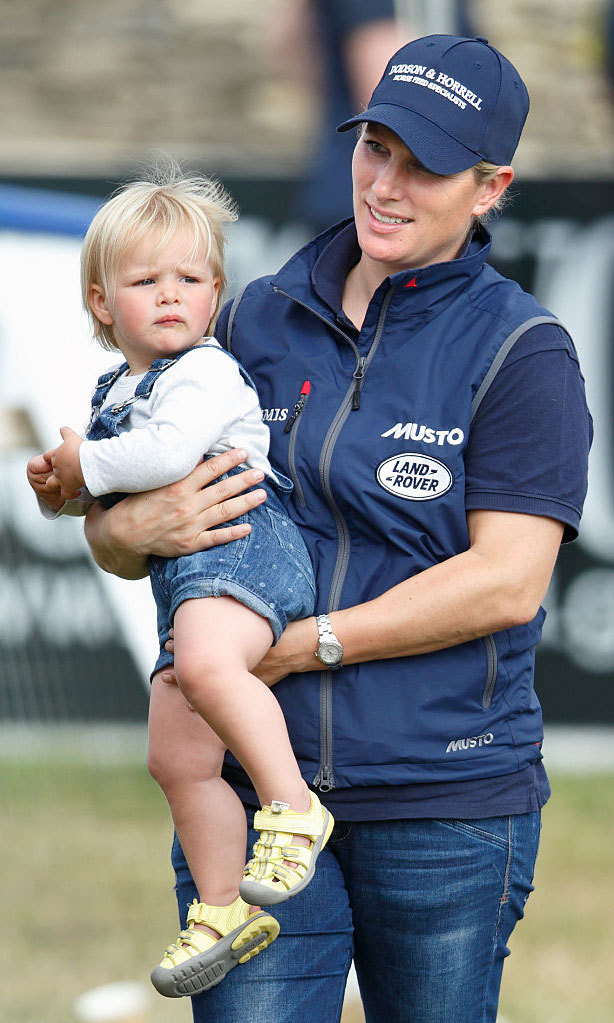 Like, mother, like daughter. Zara and Mia sported denim ensembles, wearing jeans and overalls, for fun at the Festival of British Eventing.