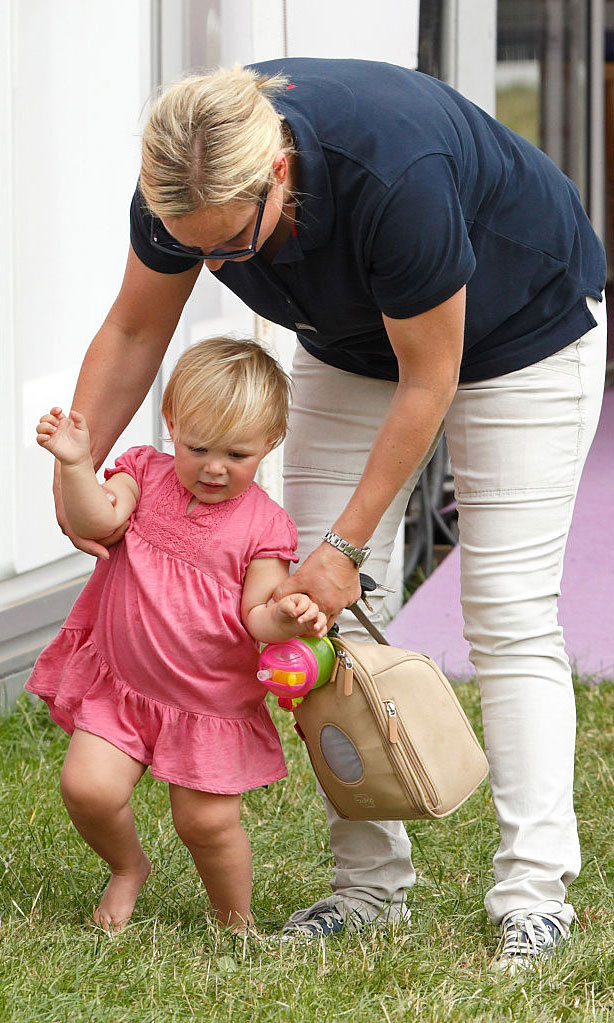 Mia got by with a little help from her mom! The adorable tot received a hand from Zara during a day out at the Festival of British Eventing at Gatcombe Park.