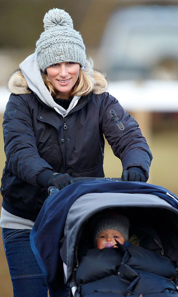 Riding with her mama! Mia got a push from her mom, while out at the Cocklebarrow Racecourse.