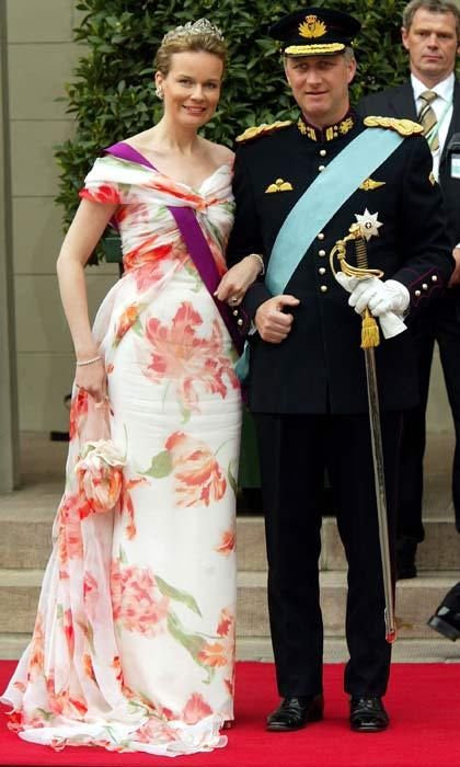 The then Princess Mathilde of Belgium opted for a white flower print dress. The royal's light summery gown brightened up the dark skies that were clouding over Copenhagen.