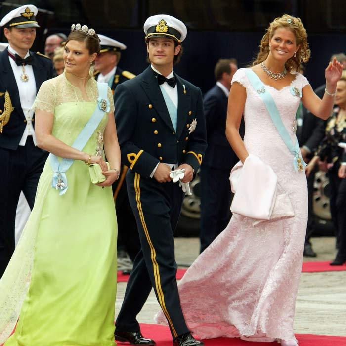 It was a family affair for the Swedish royals. Foregoing dates, Crown Princess Victoria, Princess Madeleine and Prince Carl Philip attended the royal wedding together with their parents, King Carl Gustaf and Queen Silvia. The two sisters looked beautiful both opting for brightly colored dresses.