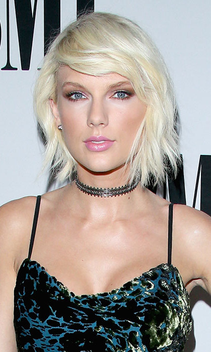 <b>Taylor Swift</b> flaunted her edgy side at the BMI Pop Awards, with her platinum blonde bob worn down in tousled waves, complemented by winged eyeliner and pale pink lipstick.
