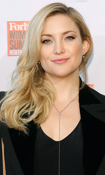 <b>Kate Hudson</b> turned heads at the Forbes Women's Summit, her long blonde tresses swept to the side, paired with shimmering pink eye shadow and lipgloss, as well as a slick of black winged eyeliner.