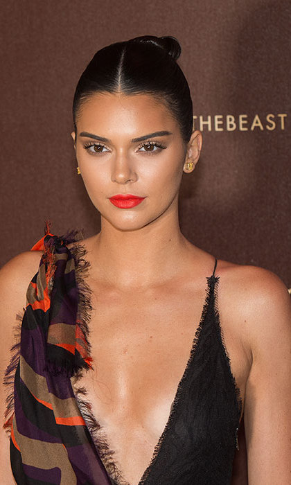 <b>Kendall Jenner</b> looked every inch a supermodel with her black tresses slicked back into an elegant chignon, paired with a statement red lipstick as she attended a party in Cannes.
