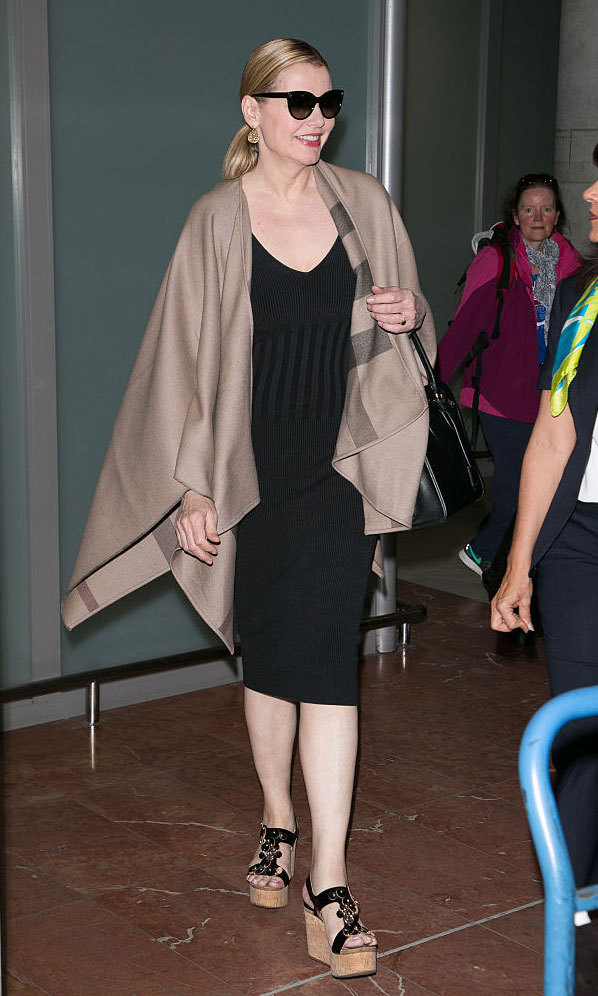 May 15: Actress Geena Davis was the definition of comfy chic wearing a little black dress, which she paired with a camel poncho and black shades.