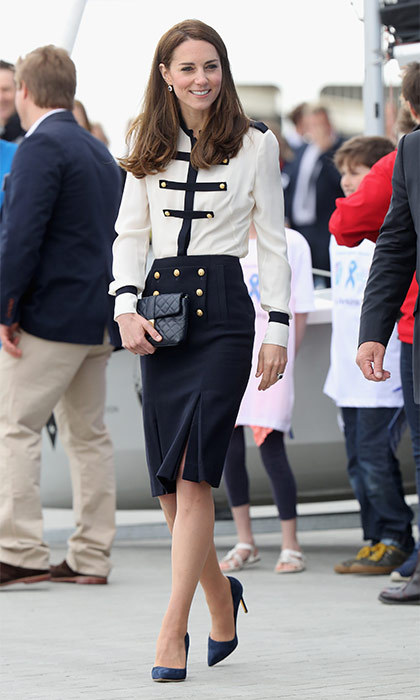 Kate looked chic as she arrived in Portsmouth wearing a Alexander McQueen skirt and top with black pumps. The royal chose to keep her makeup to a minimum and left her hair down in loose waves.