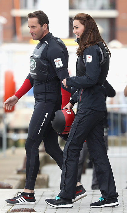 Quick change! After meeting with the school children the Duchess had the opportunity to take to the seas. Changing out of her McQueen outfit and into a sailing suit, Kate joined British Athlete Sir Ben Ainslie on the America's Cup test boat.