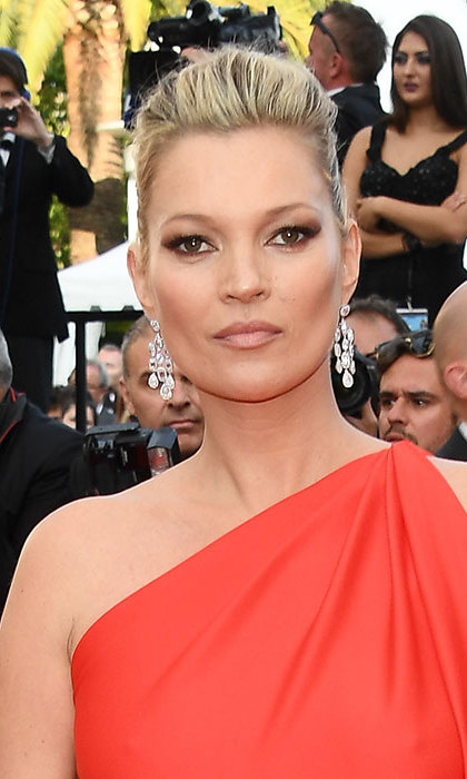 Kate Moss was simply dazzling as she arrived at the <i>Loving</i> premiere. Her hair swept back into a slightly undone ballerina bun, she teamed her hairstyle with a flawless winged eyeliner, colorful eyeshadow and nude lips.