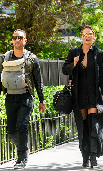 May 16: Chrissy Teigen took a stroll around NYC with her husband John Legend and their new baby girl Luna. 