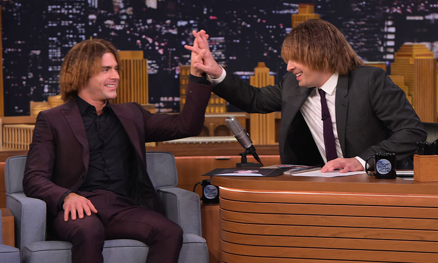 May 18: Wigging out! Zac Efron and Jimmy Fallon had some fun with one of Zac's old hairstyles during his appearance on the <i>Tonight Show</i>