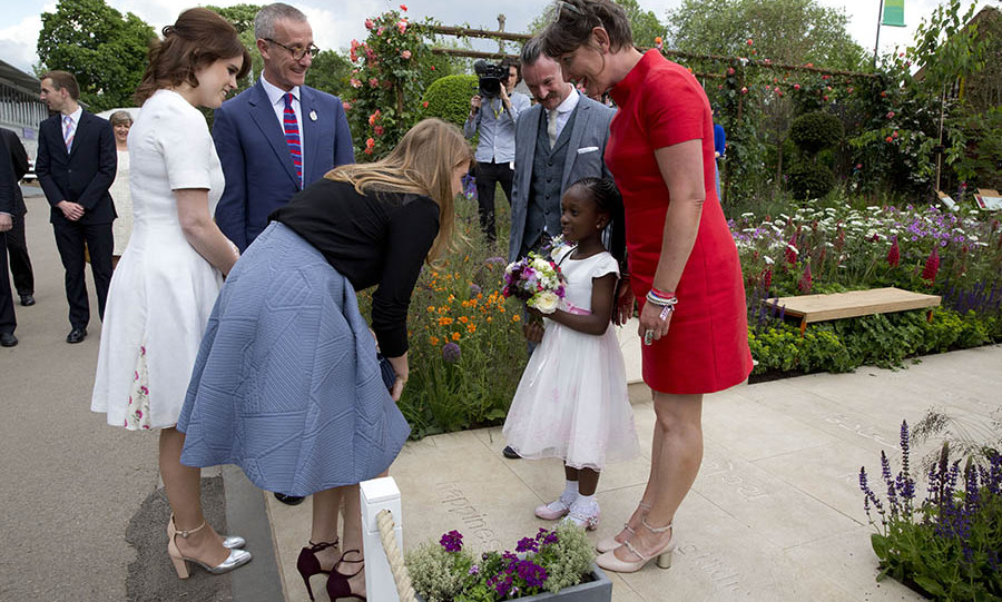 Sweet meetings in the garden! Princess Eugenie and Princess Beatrice met with six-year-old Tavesha Steele from Brixton in the RHS Greening Grey Britain Garden by Anne-Marie Powell.
