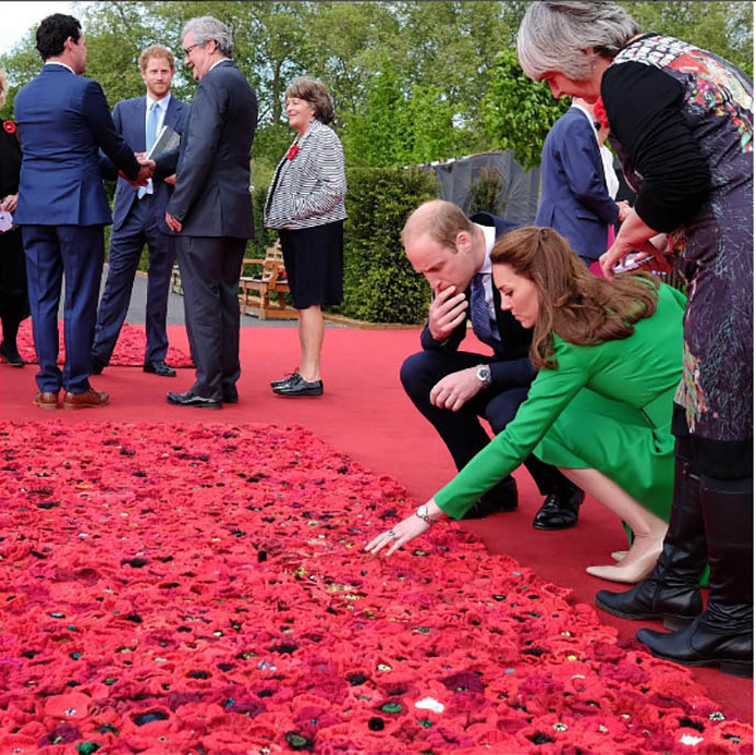 Royal exploration! William and Kate explored the 5,000 Poppies Garden, which honors fallen soldiers around the world and took the time to look and even touch the flowers. 