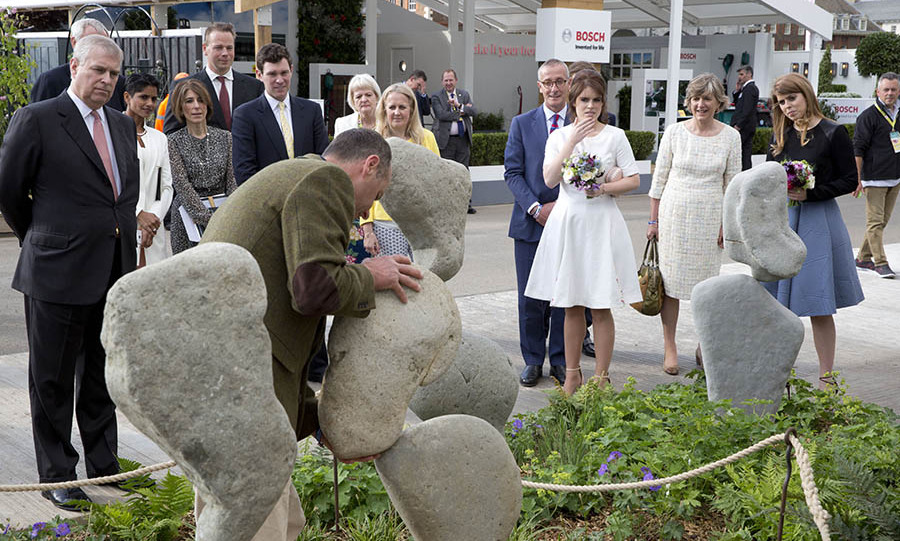 Prince Andrew, Princess Beatrice, Princess Eugenie and Jack Brooksbank stopped to look at the stand of Adrian Gray Stonebalancing.