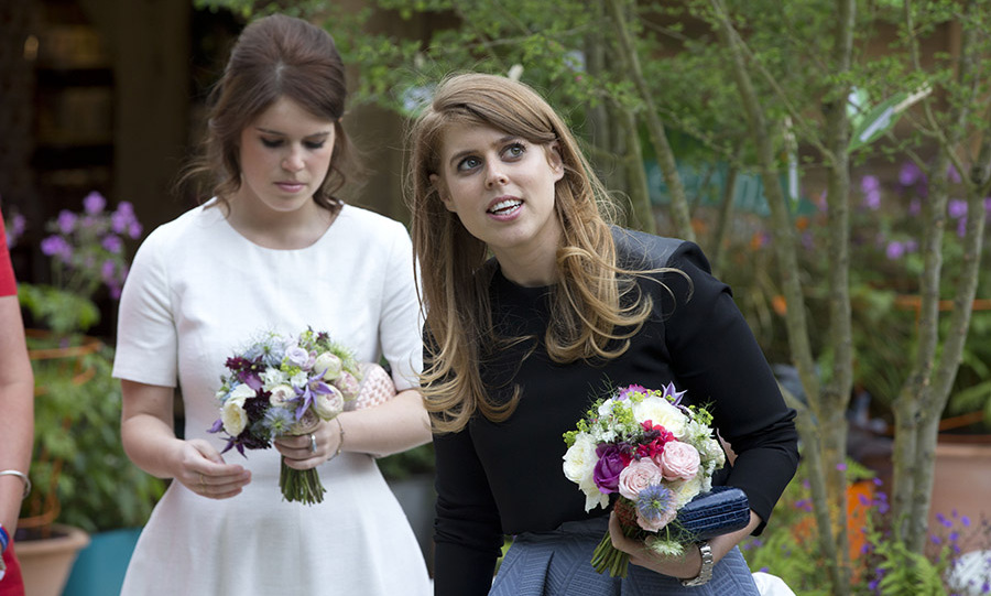 A flower for my sister! After meeting a young student, Princess Eugenie and Princess Beatrice grabbed a couple of floral arrangments at the Greening Grey Britain Garden by Anne-Marie Powell.