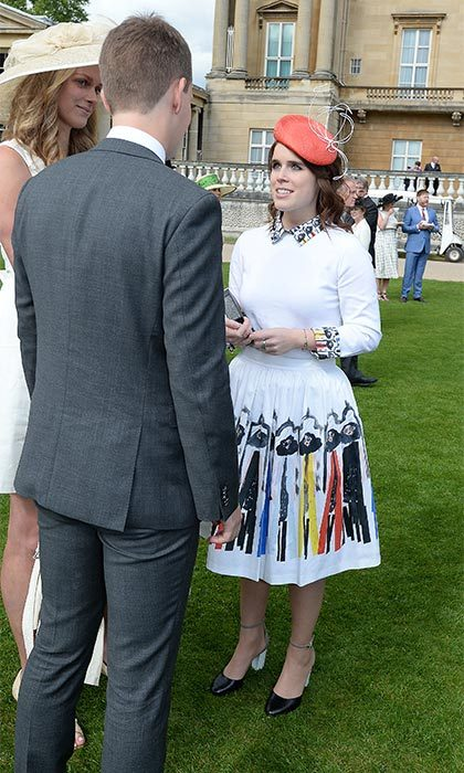 Her sister Princess Eugenie looked equally as chic, wearing an eye-catching white skirt featuring an artistic design. Queen Elizabeth's granddaughter happily chatted with guests at the outdoor event.