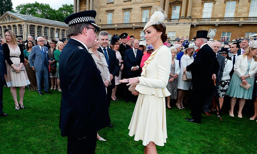 All eyes were on Kate as she greeted guests on the luscious palace lawns. The mom-of-two wore the same cream Alexander McQueen outfit that she famously wore at Prince George's christening back in 2013.
