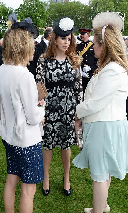 Princess Beatrice looked lovely at the official engagement wearing a black and white print dress and a matching monochrome fascinator.
