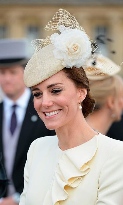 The Duchess accessorized her outfit with the same Jane Taylor hat she wore at her son's baptism, but chose to have her hair swept up into an elegant chignon for Tuesday's spring event.
