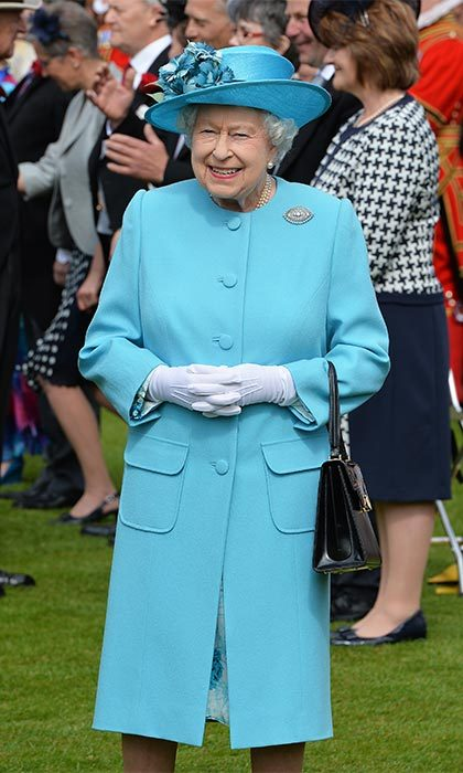 The Queen, who was hosting the party, was resplendent in a bright blue Stewart Parvin outfit, paired with a hat by Rachel Trevor-Morgan.