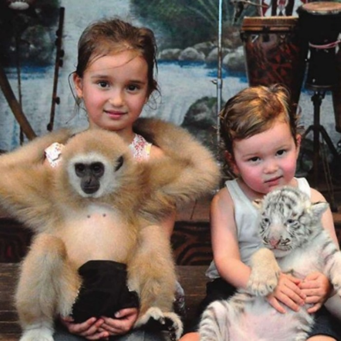"Who needs a puppy when you've got exotic animals? Ivanka shared an adorable throwback snap of Arabella and Joseph posing with a monkey and tiger cub, which she captioned, ""When you say no to a dog (for now!!) and your children set their sights on exotic animals instead.""