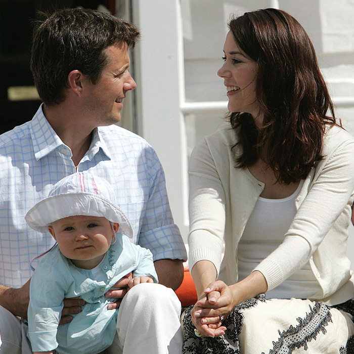 The future King holds son Christian – and has eyes for Crown Princess Mary – during a photoshoot on the steps of Grasten Castle in 2006. 