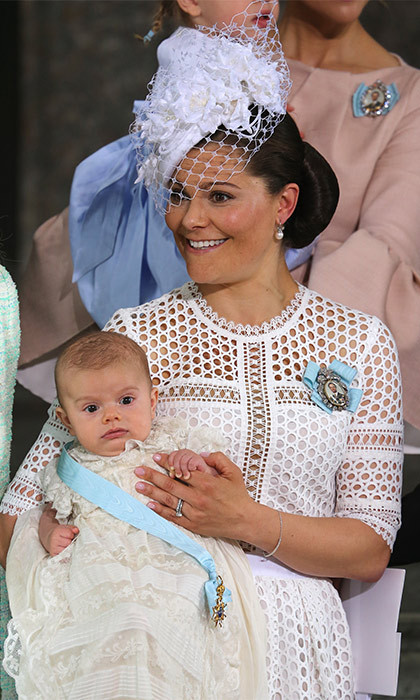Crown Princess Victoria arrived at the chapel carrying her adorable son Prince Oscar, who was born on March 2, 2016. Victoria, next-in-line to the Swedish throne, looked lovely in a white lace dress and matching fascinator.