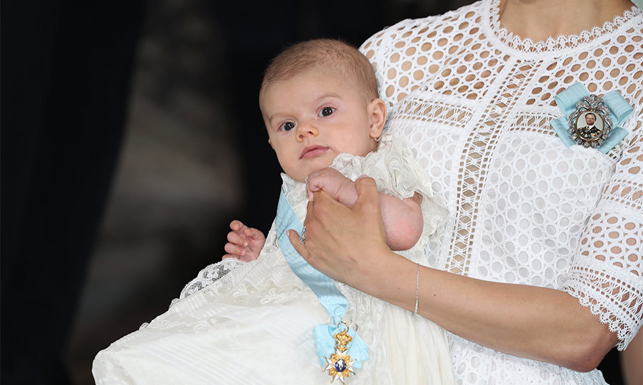 After presenting their baby boy, who was wearing his new sash and order, to well-wishers outside the chapel, the party then moved on for a reception and private lunch in the palace.