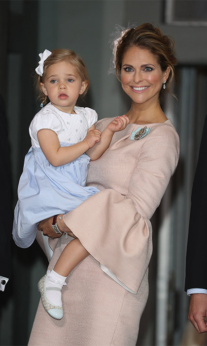 Oscar's aunt Princess Madeleine attended the ceremony with husband Chris O'Neill, son Nicolas and  two-year-old daughter Leonore (pictured). The mom-of-two looked radiant at the christening wearing a blush pink dress with bell sleeves.