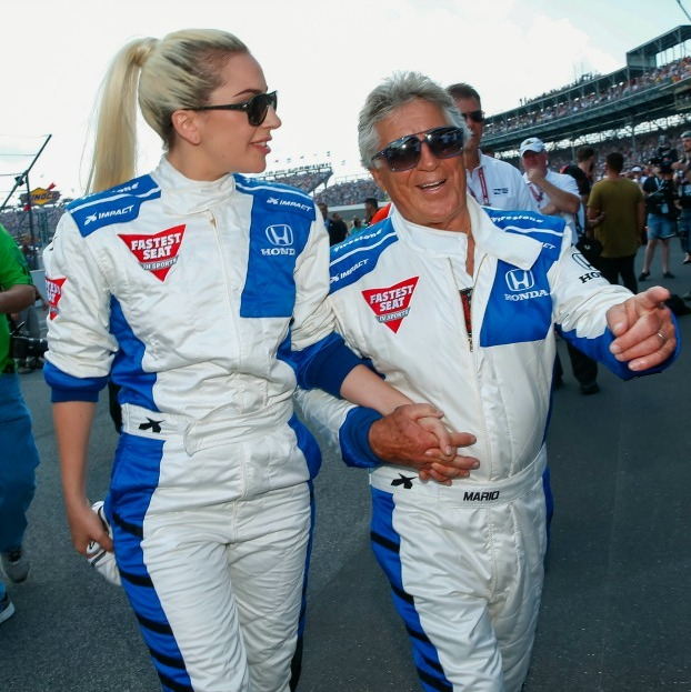 May 29: Arm in arm! Lady Gaga held Mario Andretti's hand before the start of the Indy 500 at the Indianapolis Motor Speedway in Indianapolis.