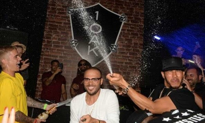 May 28: Party all night! Lewis Hamilton, Justin Bieber and club owner Richie Akiva celebrated the Grad Prix at F1 OAK pop up in Monaco by spraying some Armand de Brignac champagne.