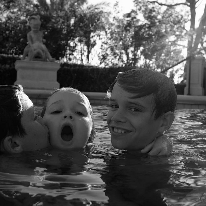 <b>He enjoys quality pool time</b>