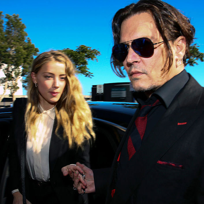 During the summer of 2015, Amber was charged with illegally smuggling her and Johnny's two Yorkshire terriers (Pistol and Boo) into Australia. 