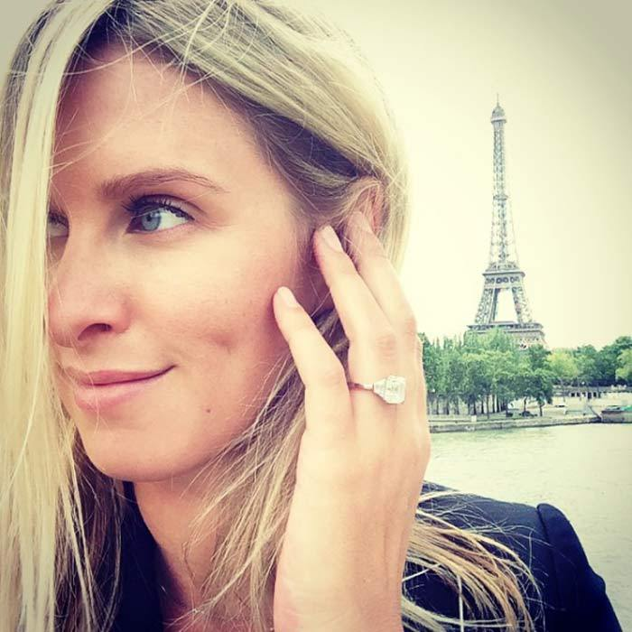 "The fashion designer showed off her stunning engagement ring in a Instagram snap taken during the couple's ""engagementmoon"" in Paris.